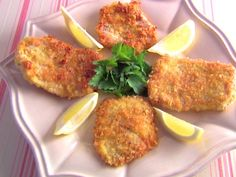 Get this all-star, easy-to-follow Pork Milanese recipe from Giada De Laurentiis