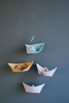 Boat Mobile via Les Fleurs maybe figute out how to make the paper boats look like ships with mast sail?