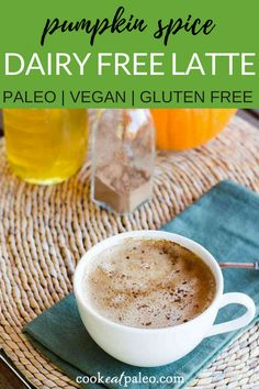 This pumpkin spice latte includes all the flavors of fall—and coconut milk makes it rich, creamy, and dairy-free. No stopping at the coffee shop required! You can also substitute maple syrup for the honey to make a #vegan version. The perfect treat to have with breakfast or a snack! #paleo #glutenfree #dairyfree #paleodiet #cookeatpaleo