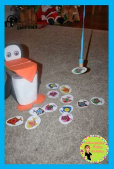 Free penguin fishing game. Free shapes and number fish!