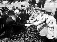 Veterans of the Union and Confederacy shake hands on the 50th anniversary of the Battle of Gettysburg 1913.