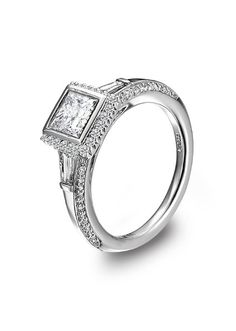 Ritani platinum diamond engagement ring features a bezel set princess cut semi mount and tapered baguette side stones with plank shank.