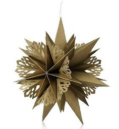 Gold Paper Snowflake Hanging Christmas Decoration. This flat-packed decoration unfolds to create a gorgeous gold paper snowflake to adorn your room and add a festive 'wow' factor to your decorations.. Price: $15.00
