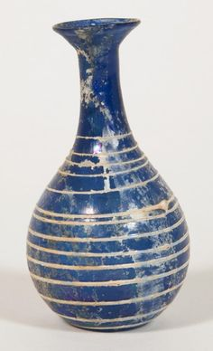 """1st AD Roman blown glass bottle with trailed thread decoration. 7.6 x 3.9 x 3.9 cm (3"""" x 1 1/2"""" x 1 1/2""""). Gift of Theodore W. and Frances S. Robinson, 1949.1141"""