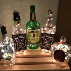 Lighted Wine Bottle Lamps by HumbleHandMeDowns on Etsy Alcohol Bottle Crafts, Alcohol Bottles, Wine Bottle Crafts, Alcohol Bottle Decorations, Beer Party Decorations, Liquor Bottle Lights, Lighted Wine Bottles, Empty Liquor Bottles, Lights In Bottles
