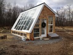 Oh to have a greenhouse, especially as cute as this.