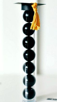 Use gumballs to create graduation cap souvenirs! Cut a cap out of cardstock and fill a plastic tube with the colors of your choice. Find this idea on Pinterest.   - Seventeen.com