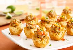 Mini puff pastry tarts are filled with a spicy chicken mixture and topped with melted cheese to make this outrageously good appetizer.
