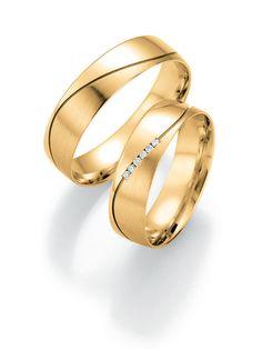 Trauringe in Gelbgold: -   Ringbreite: 5,5 mm -  Kollektionen: Puristisch -  Steingröße & Qualität: ges. 0,03 ct w/si -  Material: Gelbgold -  Ringhöhe: 1,1 mm -  Oberfläche: mattiert, glänzend -  Lieferzeit: 7-10 Werktage