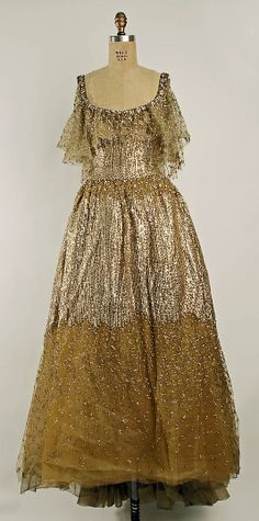Dress (Ball Gown)  House of Dior (French, founded 1947)  Designer: Marc Bohan (French, born 1926) Date: fall/winter 1961–62 Culture: French Medium: synthetics http://www.metmuseum.org/Collections/search-the-collections/80000271?rpp=20&pg=1&ft=*&what=Gowns&pos=2