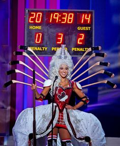 Miss Canada, Chanel Beckenlehner, poses for the judges wearing a hockey-themed costume during the national costume show at the 63rd annual Miss Universe Competition