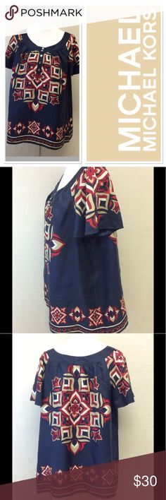 """1X MICHAEL KORS patterns flown blouse Brand: Michael Kors  Style: blouse Size: 1X Approximate Measurements: pit to pit 24""""  shoulder to hem 27""""  Material: 100% silk Features: bold pattern, logo buttons  Condition: excellent pre-loved MICHAEL Michael Kors Tops"""