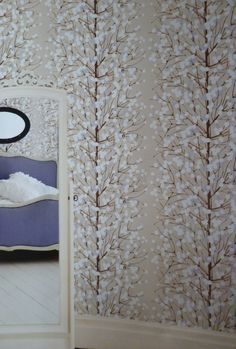 Create a snow-dusted forest in your bedroom - Lumimarja wallpaper by Marimekko
