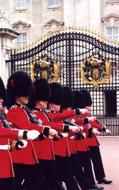 Guards marching past Buckingham Palace, London