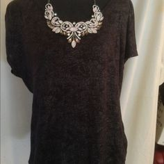 black and silver tunic by a.n.a. 2x ADORABLE Love this shirt. Black with specs of silver. Short sleeve perfect for a dress up on a summer night party. Add a statement necklace, some slacks, skirt or even jeans and you're good to go. Size is 2x with room. Gently used. Sure to love this one! a.n.a Tops Tunics