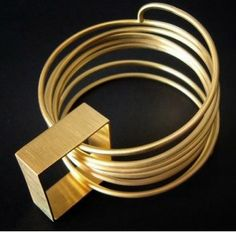 Contemporary geometric and architectural metal art jewelry by ERATO KOULOUBI-GR  in Greece - Bracelet - Goldplated bronze 2012 Photo: erato
