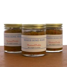 Shaker Home-made Mustard Pickle. Made by Brother Arnold Hadd, thisis a tasty relish to pair with meat dishes or on a sandwich!  Ingredients: Green tomatoes, peppers, onions, vinegar, sugar, mustard, sale, and tumeric.  6 oz glass jar with paper Shaker label.