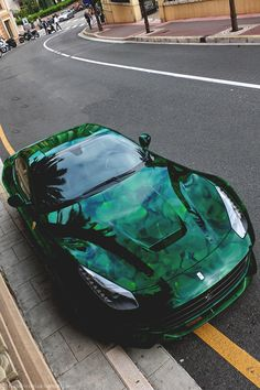 Ferrari with what looks like a design of lily pads on a black lake. #green #car