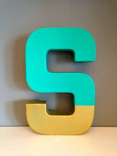 Really cute gold dipped letter!  Easy enough to DIY with some craft paint.