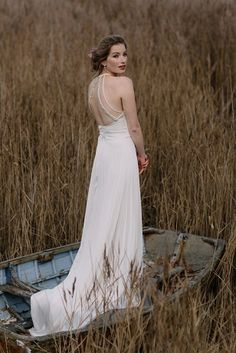 This modern backless design is made from cream Japanese handmade silk and features our trade mark pleated skirt. It includes a racer neckline and stunning beaded straps in a mixture of milky white, blush and ivory tones.