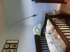 Use a fishing pole and flag pole mount to hang the mobile in an ocean theme baby's room.  (My man is a genius!!)  The mobile bounces and you can adjust it as they grow!