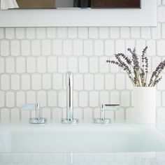 """Savoy ceramic tile collection 1-1/4"""" x 2-3/8"""" hive on a 11-1/2"""" x 12-5/8"""" sheet, in Ricepaper gloss finish. Plumbing and console table are Kallista."""