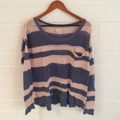 Billabong Sweater Pink as Blue striped Billabong sweater. Small pocket on left chest. High-low waistband. Loose fitting, slightly sheet. I usually wear a tank top under this sweater. Billabong Sweaters Crew & Scoop Necks