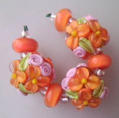 BLISS Coral Wild Blossom and Rosebuds Lampwork Floral Lentil Trio | blissfulgardenbeads - Jewelry on ArtFire