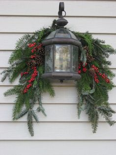 Evergreen swag with berries and lantern