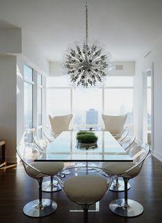 Sputnik style chandelier:  clear chairs