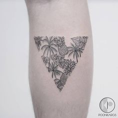 Tropical triangle tattoo on the right calf.