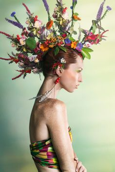 Green Fashion http://www.gettyimages.co.uk/detail/photo/woman-wearing-a-colorful-floral-mohawk-high-res-stock-photography/158049960