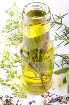 Steeping an mixture of herbs in oil | Foodal.com