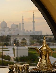 In the classic city of Abu Dhabi, an elegant gold cast tea setting likens a magic lamp; one filled with dreams and promise. Abu Dhabi, Dubai Travel, Grand Mosque, Sharjah, Dubai Uae, United Arab Emirates, Dream Vacations, Places To See, Travel Inspiration