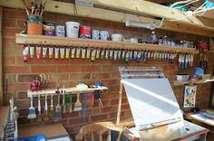 Clever idea using aligator clips to put on the end of paint tubes and hang on nails.