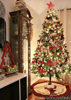 Christmas Tree with Plaid garland, handmade ribbons, Chalkboard Wood slice ornaments, and a plaid deer head tree skirt.