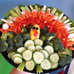 I did it! Thanksgiving turkey made of vegetables: arrange cut veggies in a semi circle around tray; use a small yellow squash for the body; eyes, beak, etc. are made from olives and peppers (attached with toothpicks).
