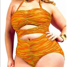 🎉SALE🎉 Plus Size Cut Out One Piece Swimwear Plus Size Cut Out One Piece Swimwear Yellow and Red Zebra print ( never worn brand new) Swim One Pieces