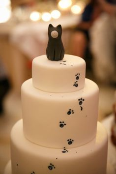 Three tier fondant cake with cute paw prints and kitty cat topper ~ we ❤ this! moncheribridals.com