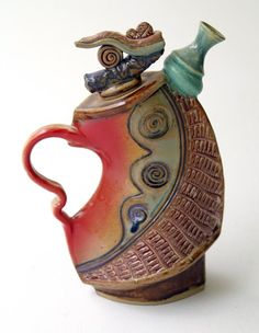 Helene Fielder. Helene has maintained a full time studio for the past seventeen years, creating in both clay and metal.  See more on her website:  http://potterybyhelene.com/