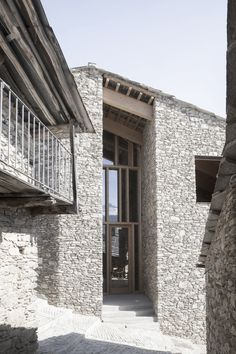 """The cultural centre """"_Lou Pourtoun_"""" is the lastest step of a revival strategy of the village of Ostana, in the upper Po Valley, based on the enhancement of . Stone Facade, Stone Masonry, Great Buildings And Structures, Modern Buildings, Kerry Hill Architects, Alpine Modern, Village Houses, Loft, Cultural Center"""