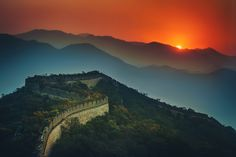 """""""The Great Wall Stretches Across the Sunset"""" by Trey Ratcliffe. #china #trey_ratcliffe #stuck_in_customs #photography #travel #sunsets #mountains #orange #blue #green #landscapes"""