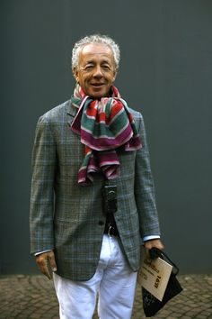 Gilles Bensimon. Color & pattern play: his colorful striped scarf and the plaid popped with blue in the blazer.