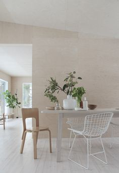 Scandinavian dining room with plywood walls.