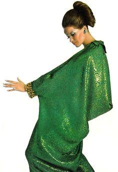 Veruschka is wearing an emerald green brocade caftan dress by Dior, 1965