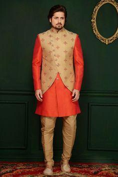 Orange banarasi Silk men's sherwani style paired with a matching art silk bottom. Mens Wedding Wear Indian, Wedding Dresses Men Indian, Indian Groom Wear, Wedding Dress Men, Indian Ethnic Wear, Mens Sherwani, Wedding Sherwani, Indian Men Fashion, Mens Fashion Suits