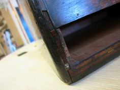 For a student, the advantage of restoring a  Victorian wooden box such as this one, is that there are many different skills required to repair the various damaged parts.