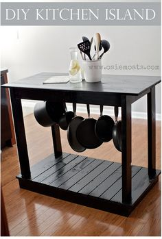 diy-kitchen-island an ikea table on a pallet with hooks under the table. Cute idea so pans aren't taking up room in a cabinet or hanging over your head.