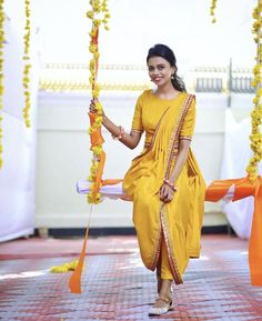 Royal Trivandrum Wedding with a South Indian Bride in Unique Outfits Classy Mehndi & Haldi outfit with a tinch of yellow ! Indian Bridal Outfits, Indian Designer Outfits, Indian Dresses, Designer Dresses, Ceremony Dresses, Bridal Dresses, Wedding Dress, Bridesmaid Dresses, Saree For Wedding