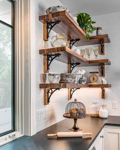 With a central circle detail supported by a broad curve, this bracket is an all-around choice for your shelves, fitting with any style. Made from a heavy cast iron with a matte black finish. Corner Shelves Kitchen, Dining Room Shelves, Open Shelf Kitchen, Corner Shelf, Rustic Shelves, Wood Shelves, Unique Wall Shelves, Decorative Shelves, Wrought Iron Shelf Brackets